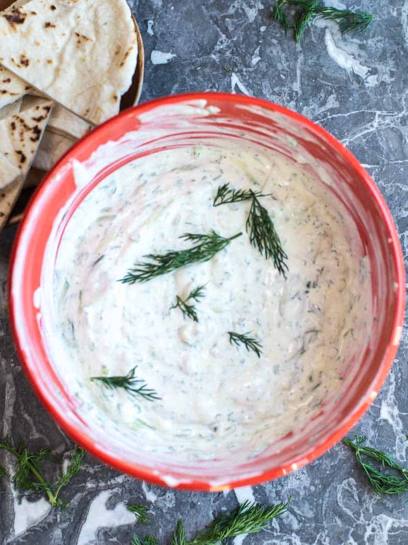 Yogurt dill sauce in a red bowl