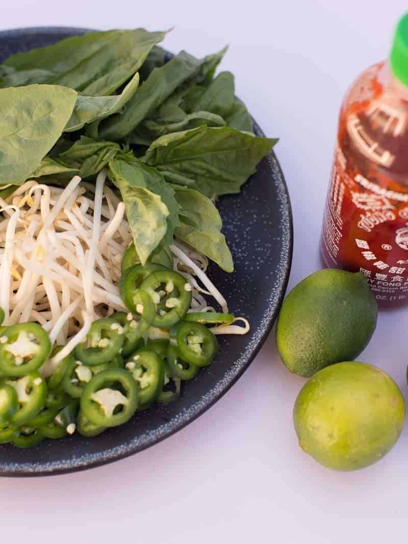 basil, bean sprouts, jalepenes, limes and sriracha for serving with shrimp vermicelli bowls.