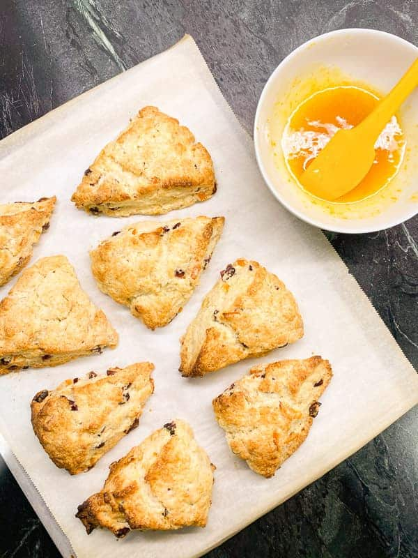 glaze the scones with an orange glaze
