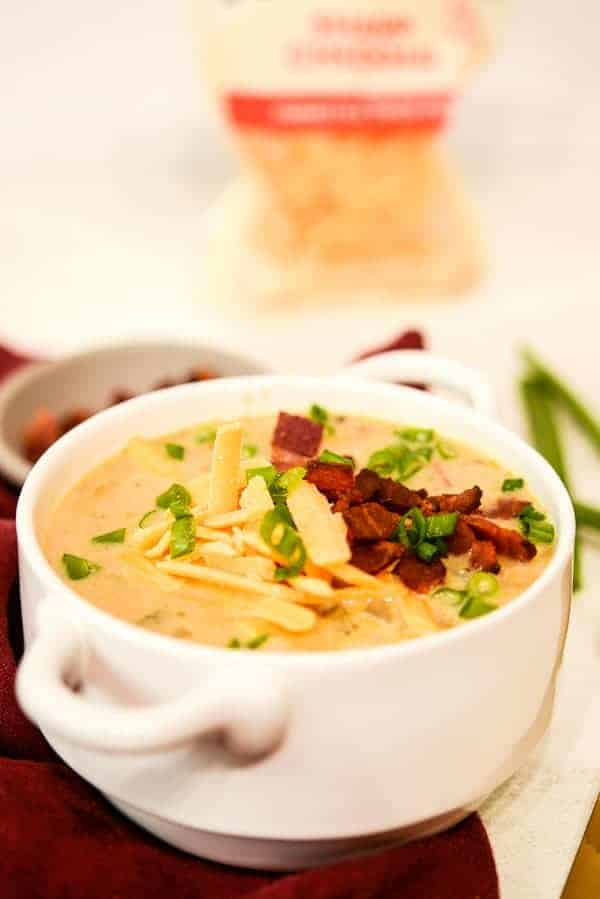 Loaded Baked Potato soup recipe with tillamook cheddar cheese in the background