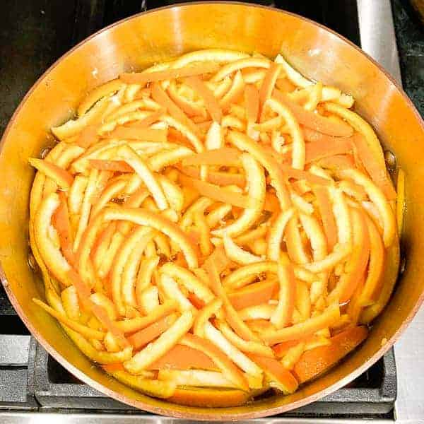boil the orange peel slices in a 6 quart sauce pan filled with fresh water.