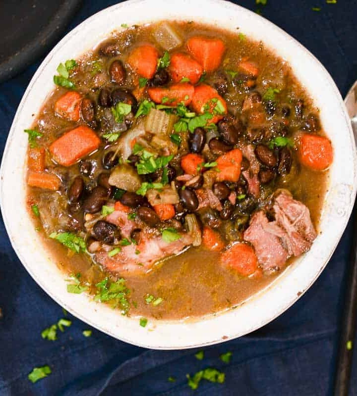 Bowl of Smoked ham and black bean soup in a white bowl.