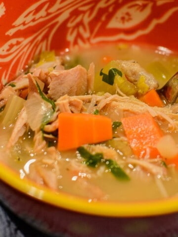 easy turkey soup recipe in an orange bowl
