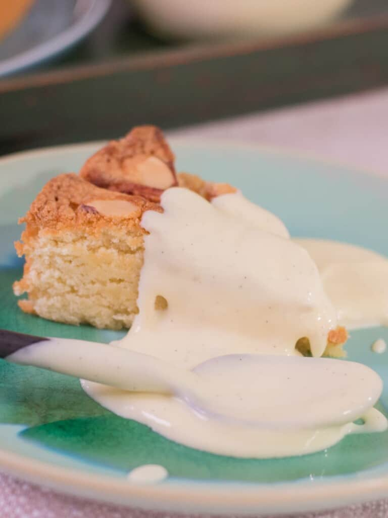 vanilla pastry cream topping on an apple cake