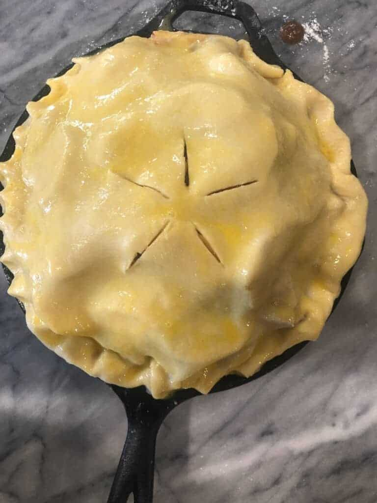 cover the apples with the second pie dough, crimp the edges, vent with a sharp knife