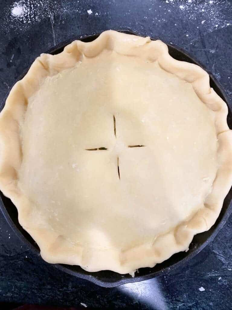 add the top pie crust and vent it with a knife