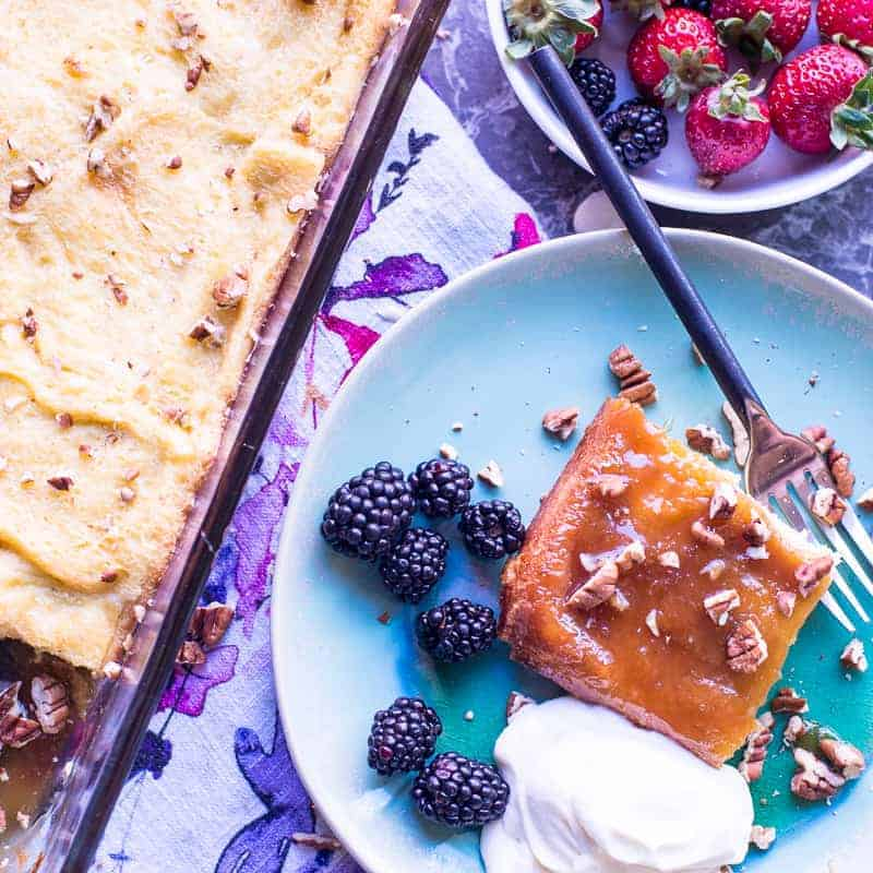 creme brulee french toast breakfast casserole served with berries and chopped pecans.