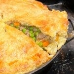 cutting a slice of turkey pot pie