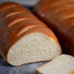 Perfect loaves of french bread sliced | foodology geek