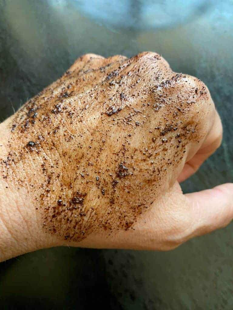 diy coffee body scrub on the back of my hand. recipe by foodology geek
