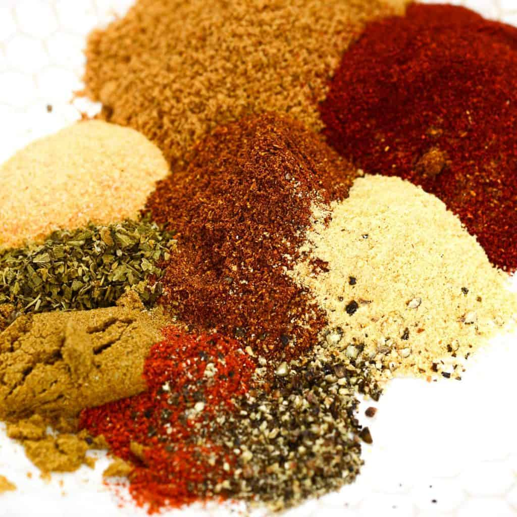 homemade bbq rub on a white plate | foodology geek