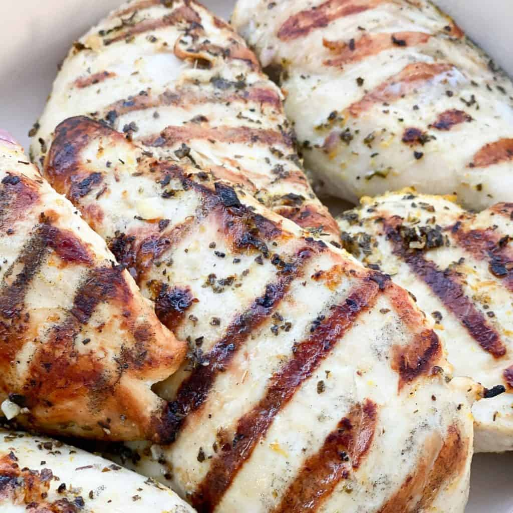 grilled chicken breasts in a le crueset pan