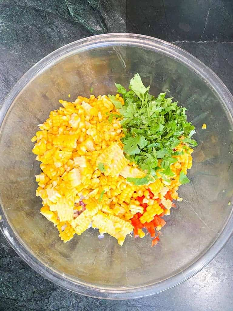 cilantro, corn, red pepper, onions, and serrano peppers