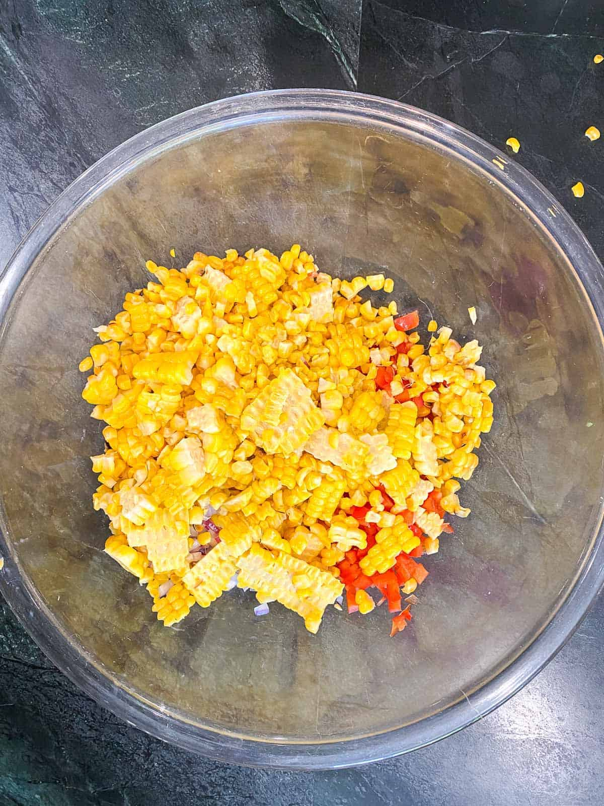 corn, red pepper, onions, serranos in a bowl