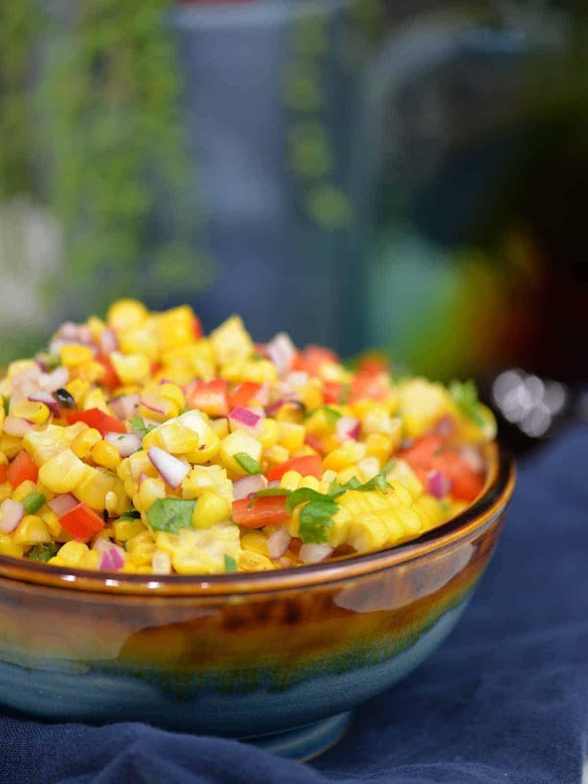 Easy corn salsa recipe in a gorgeous glazed bowl.