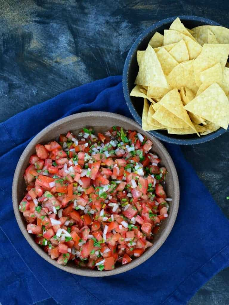 pic de gallo in a bowl, served with tortilla chips