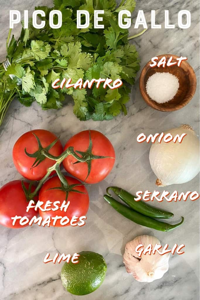ingredients for pico de gallo on a marble board