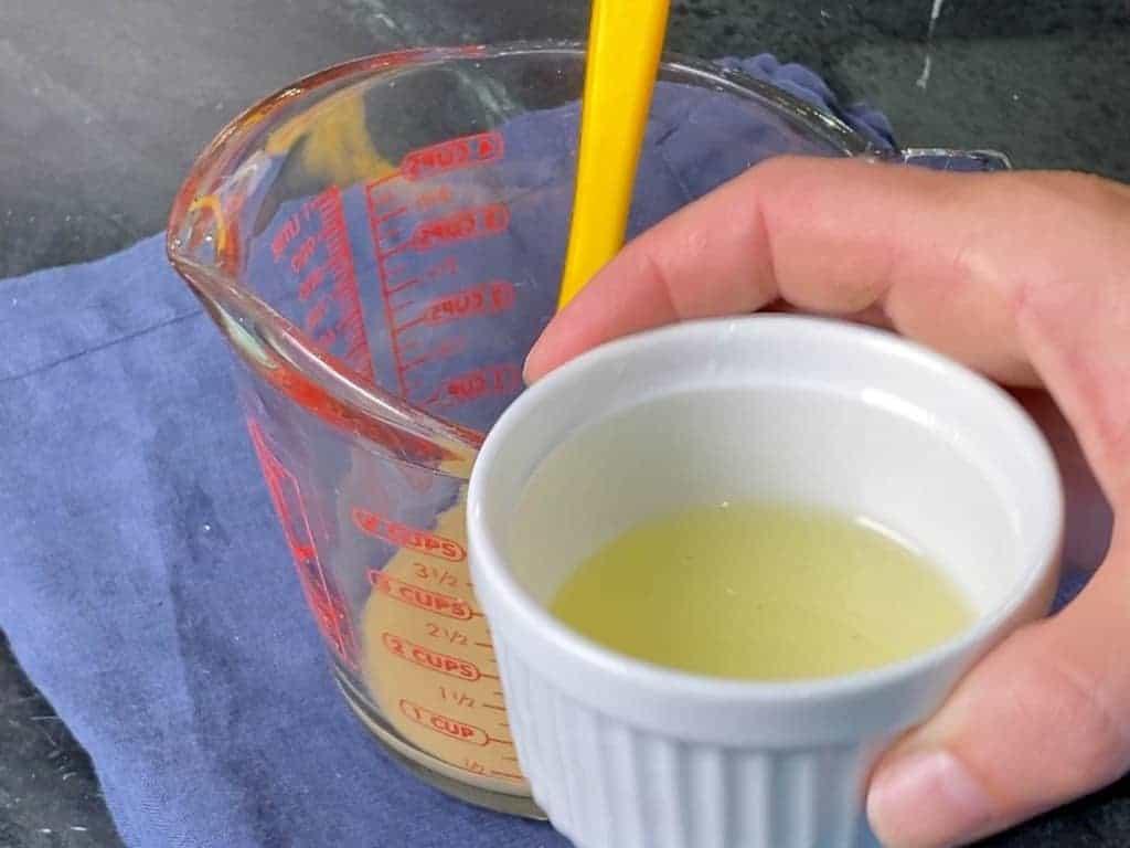 1/4 cup of lemon juice in a white remekin