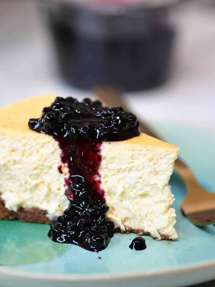 blueberry cheesecake on an aqua plate