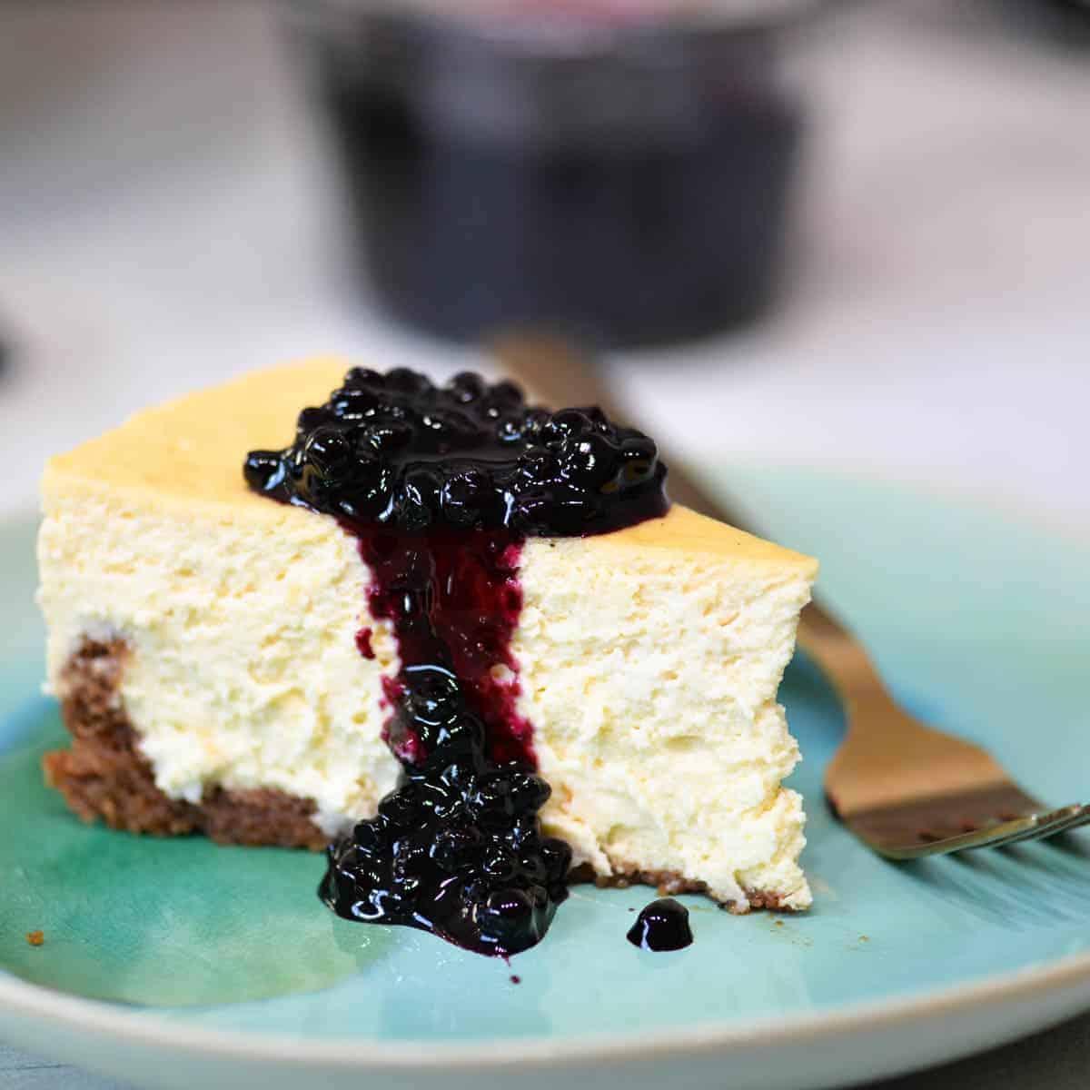 blueberry cheesecake on an aqua plate