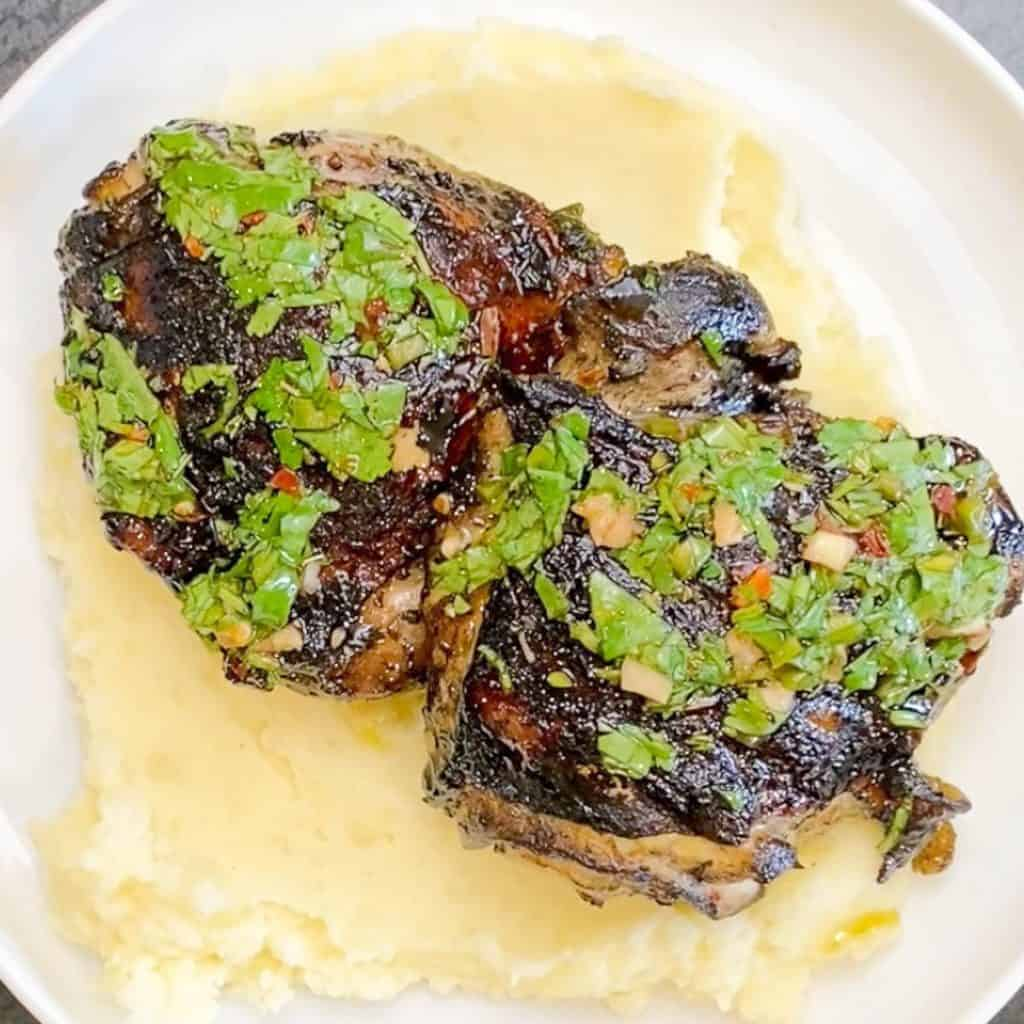 Chimichurri chicken served on a bed of goat cheese mashed potatoes. Smothered in Chimichurri Sauce.