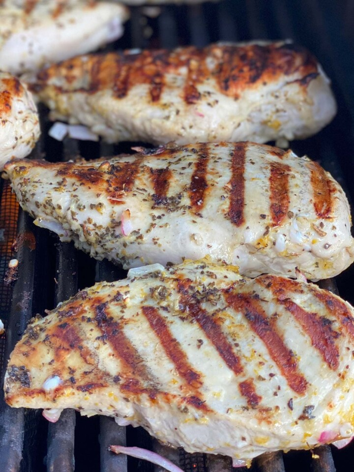 Marinated chicken breasts cooking on the grill