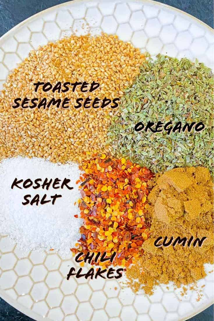 Labeled ingredients used to make Mediterranean Seasoning blend on a plate.