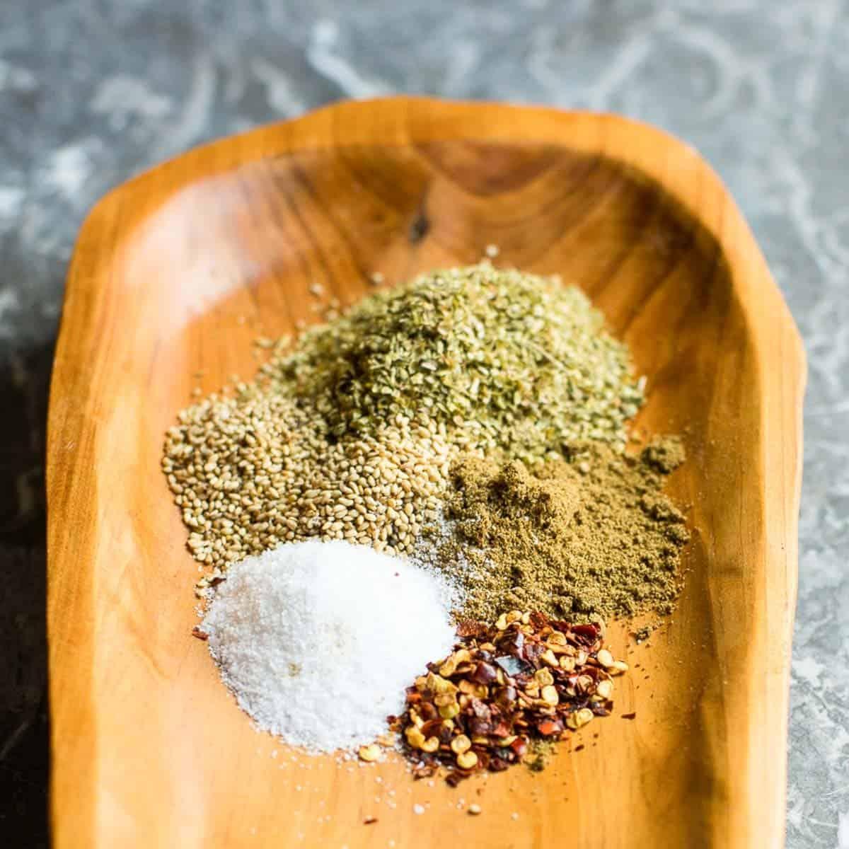 mediterranean seasoning blend recipe on a wooden dish