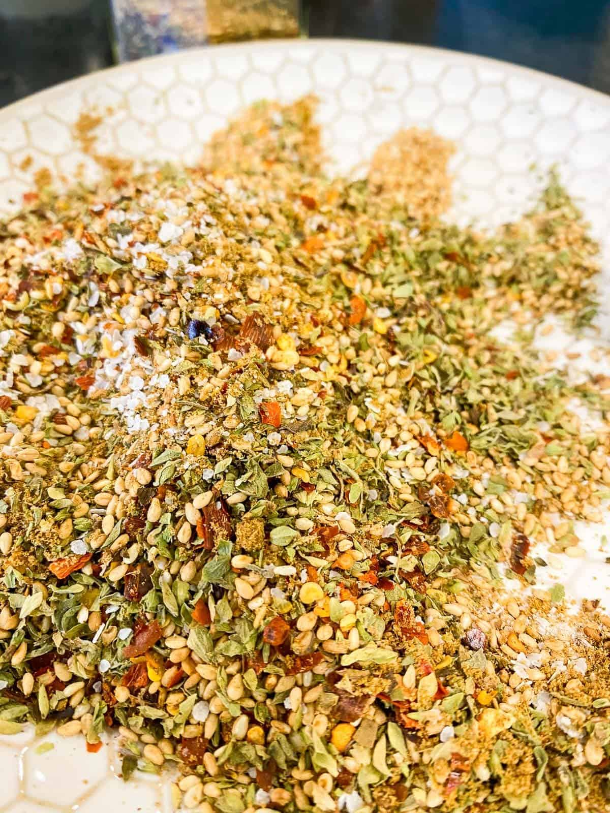 Mediterranean Seasoning on a plate ready to be stored in an airtight container.