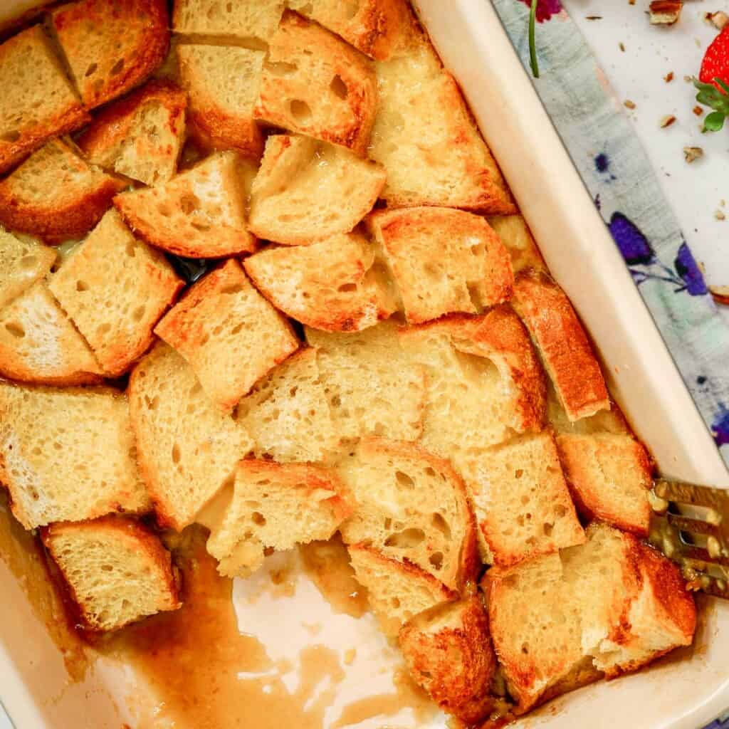 baked french toast with a slice cut out