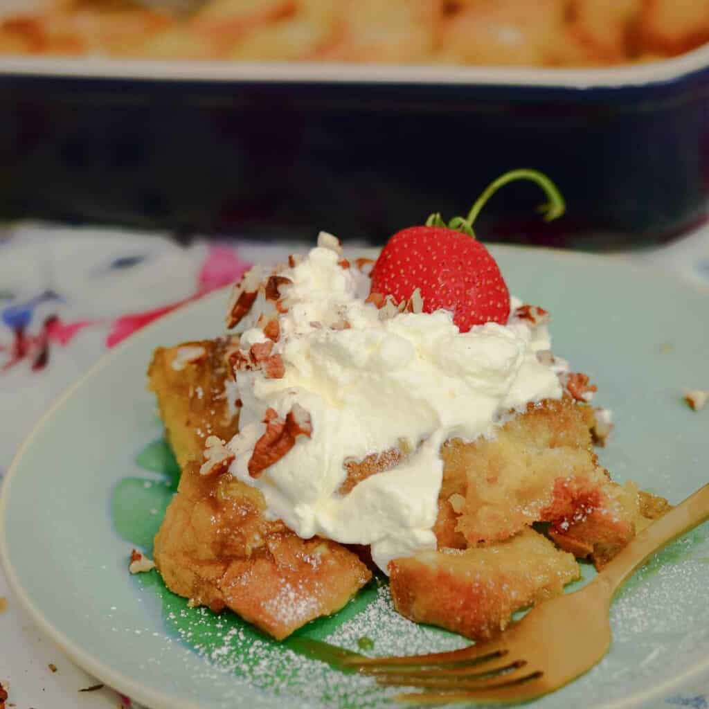 baked french toast casserole with whipped creme and strawberries