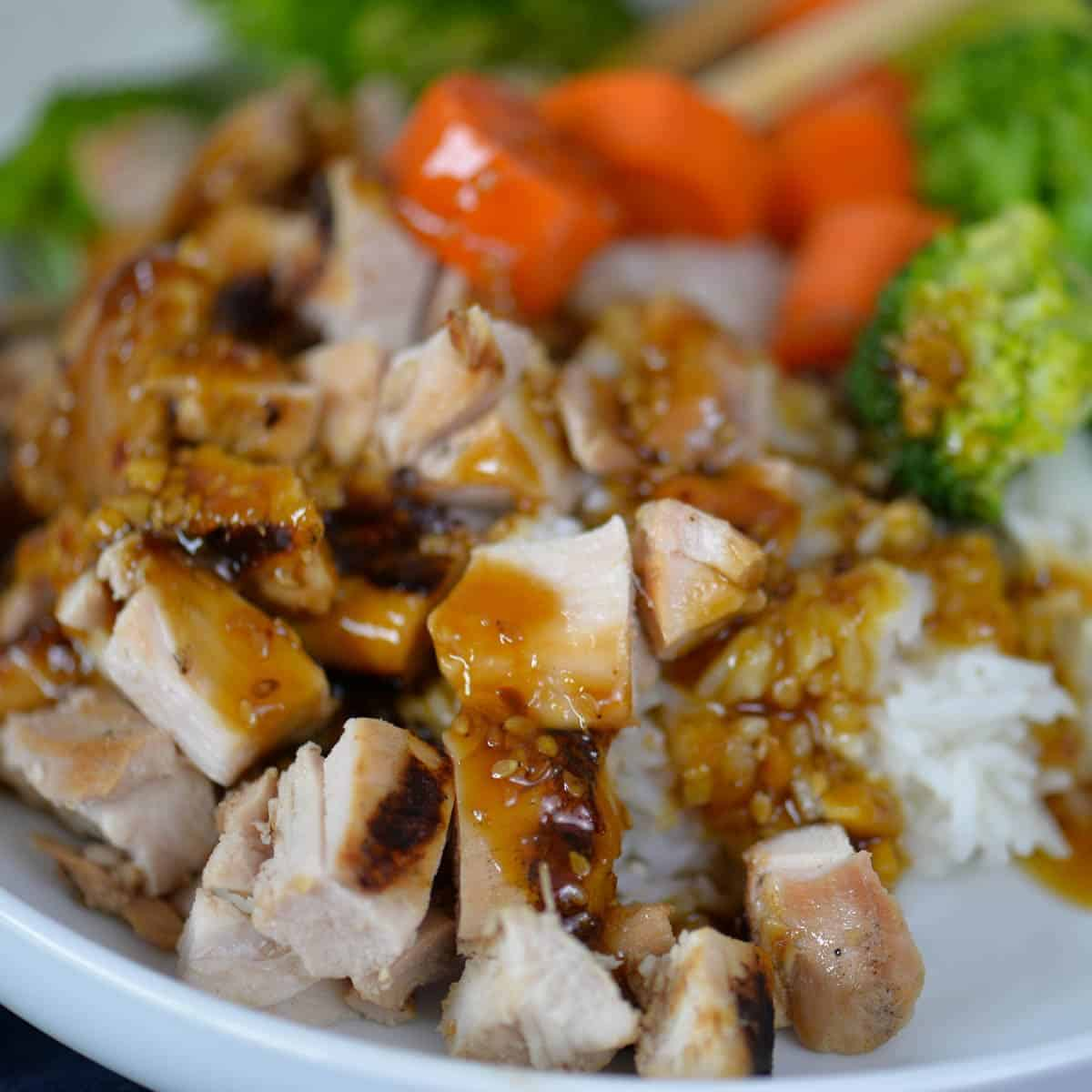 grilled teriyaki chicken bowl with grilled chicken thighs, steamed rice, and veggies