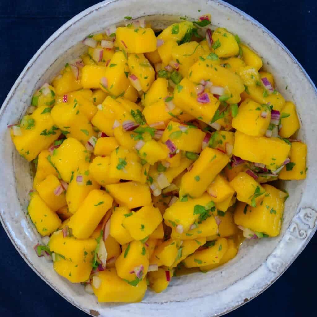 mango salsa recipe in a white bowl