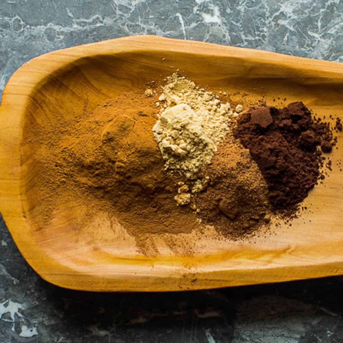 pumpkin pie spice ingredients on a wooden platter