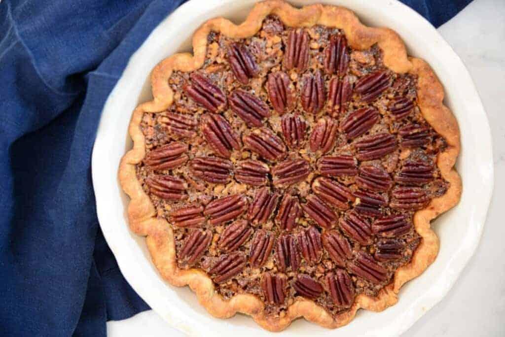 Pecan pie in a white pie dish