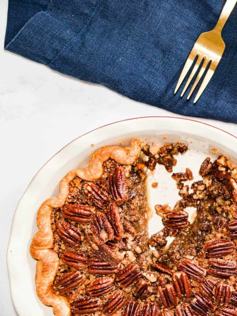 The best pecan pie recipe made with maple syrup, one slice cut out