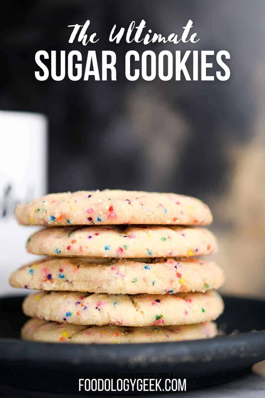 rainbow sprinkle sugar cookies stacked on a plate