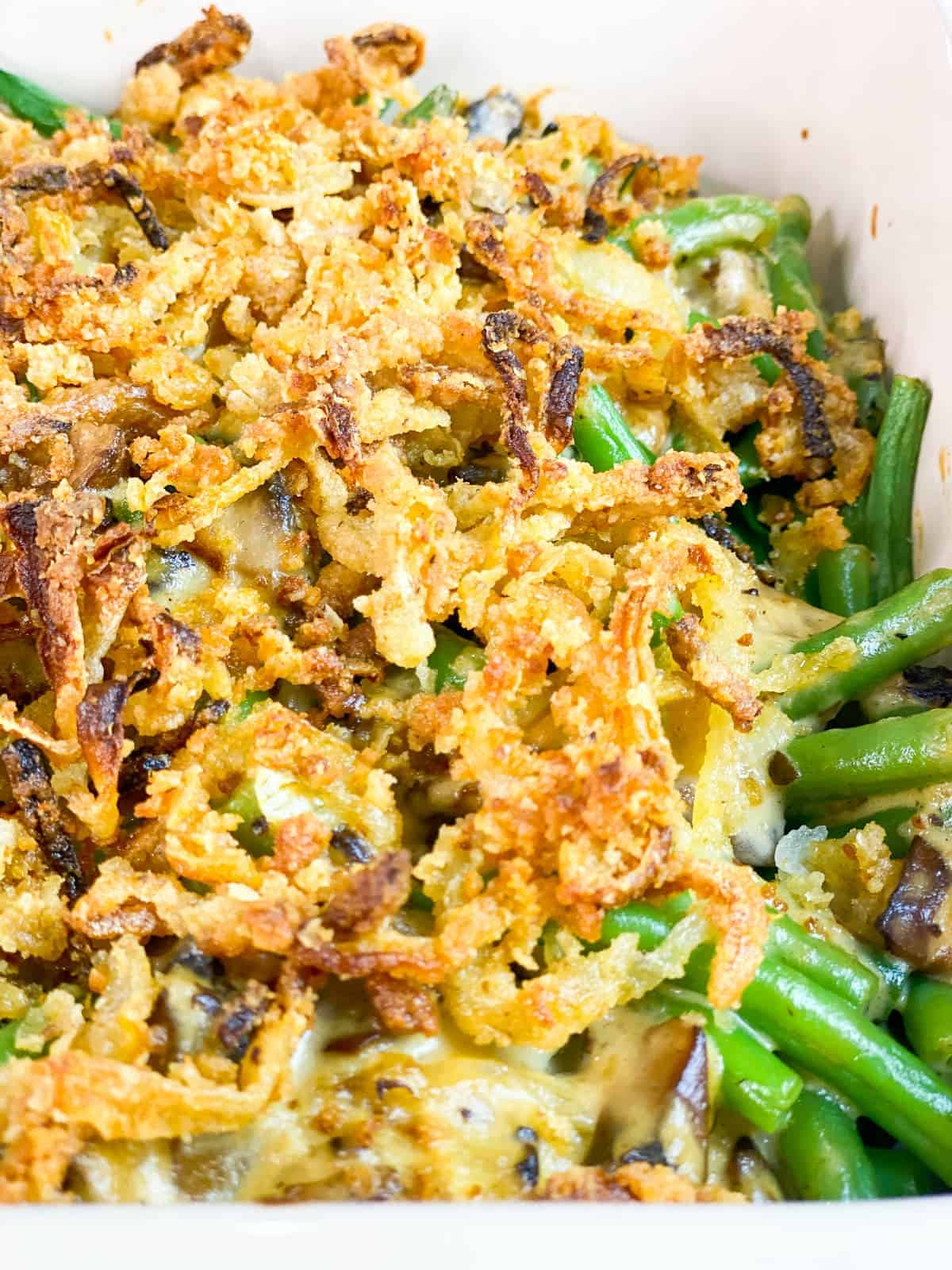 green bean casserole from scratch with a close up french fired onions