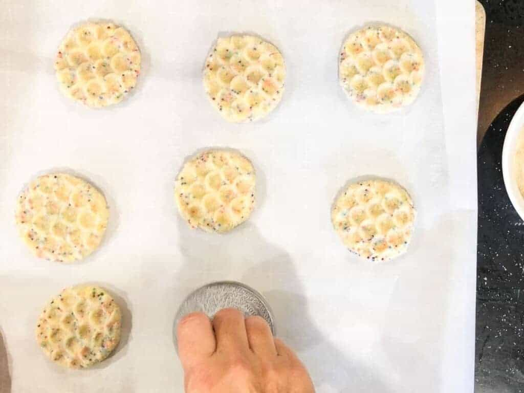 press the cookies using a cookie scoop