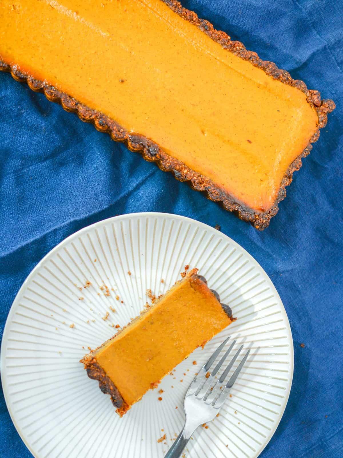 a homemade vegan pumpkin pie tart, rectangular