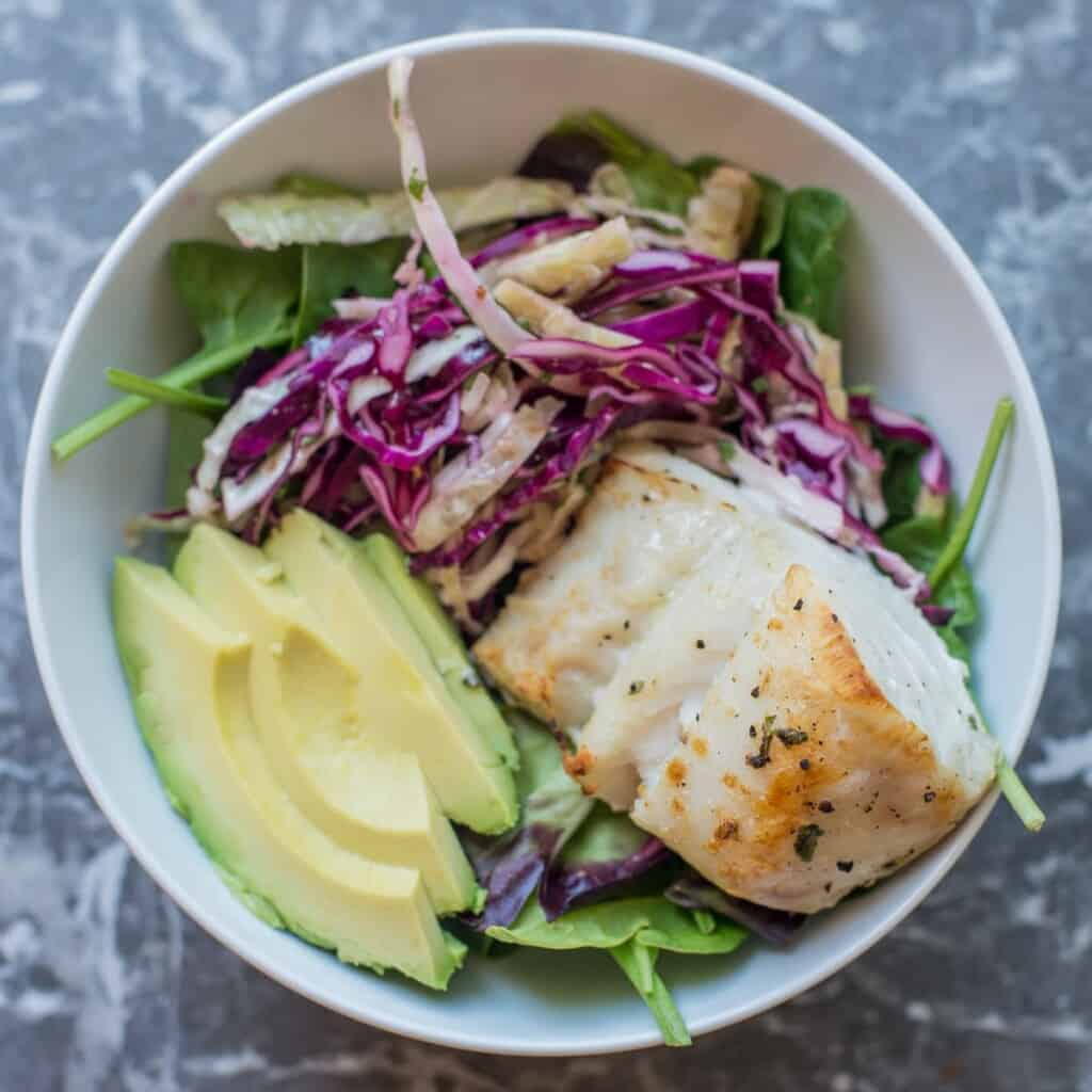 add the tequiila lime fish to the meal prep bowl