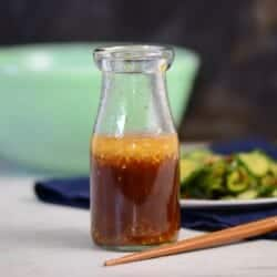 Asian Sesame Ginger Salad Dressing Recipe with chopsticks in a glass bottle