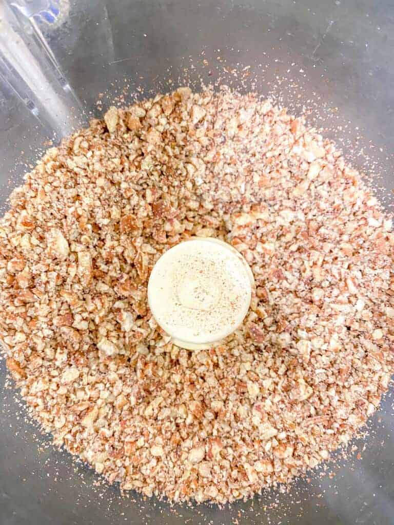 chopped pecans in a food processor bowl