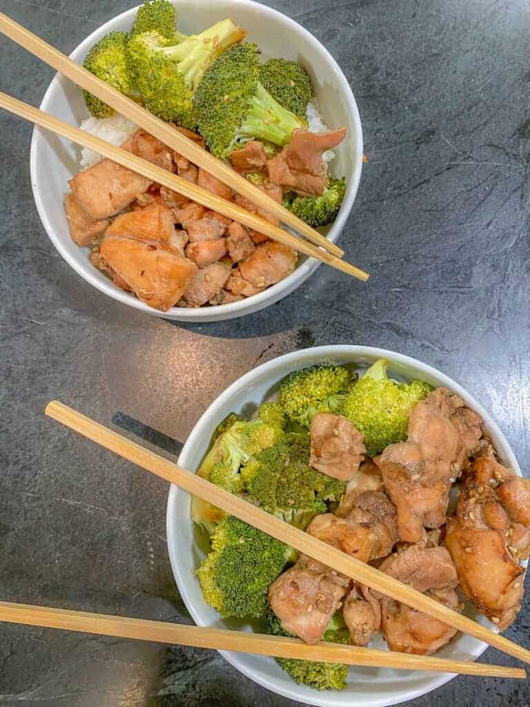 two bowls of chicken and broccoli