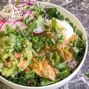 green chicken chili bowl with rice and guacamole