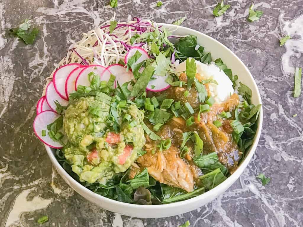 green chicken chili served with rice and guacamole