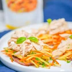 easy shredded chicken with apple slaw and sweet potatoes on a white plate