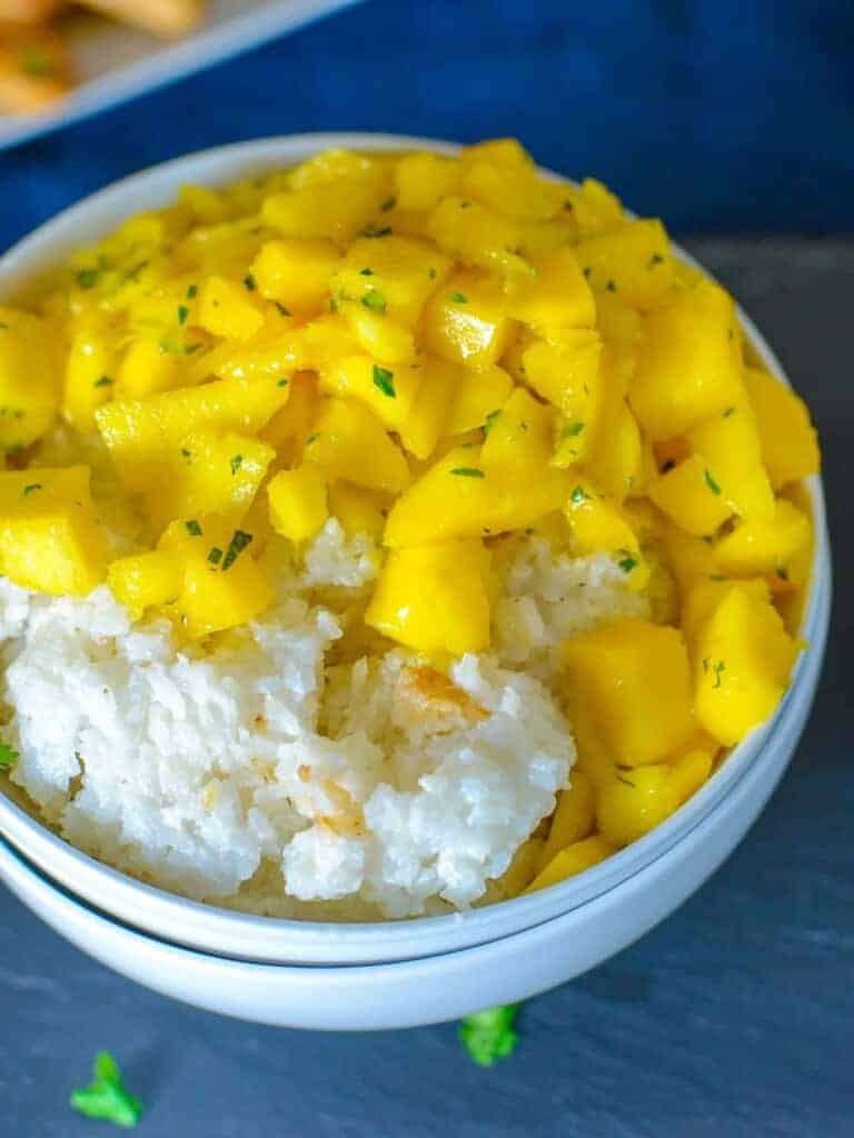 mango coconut rice in a bowl