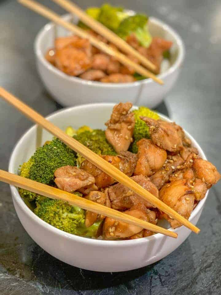 two bowls of easy chicken and broccoli with chopsticks