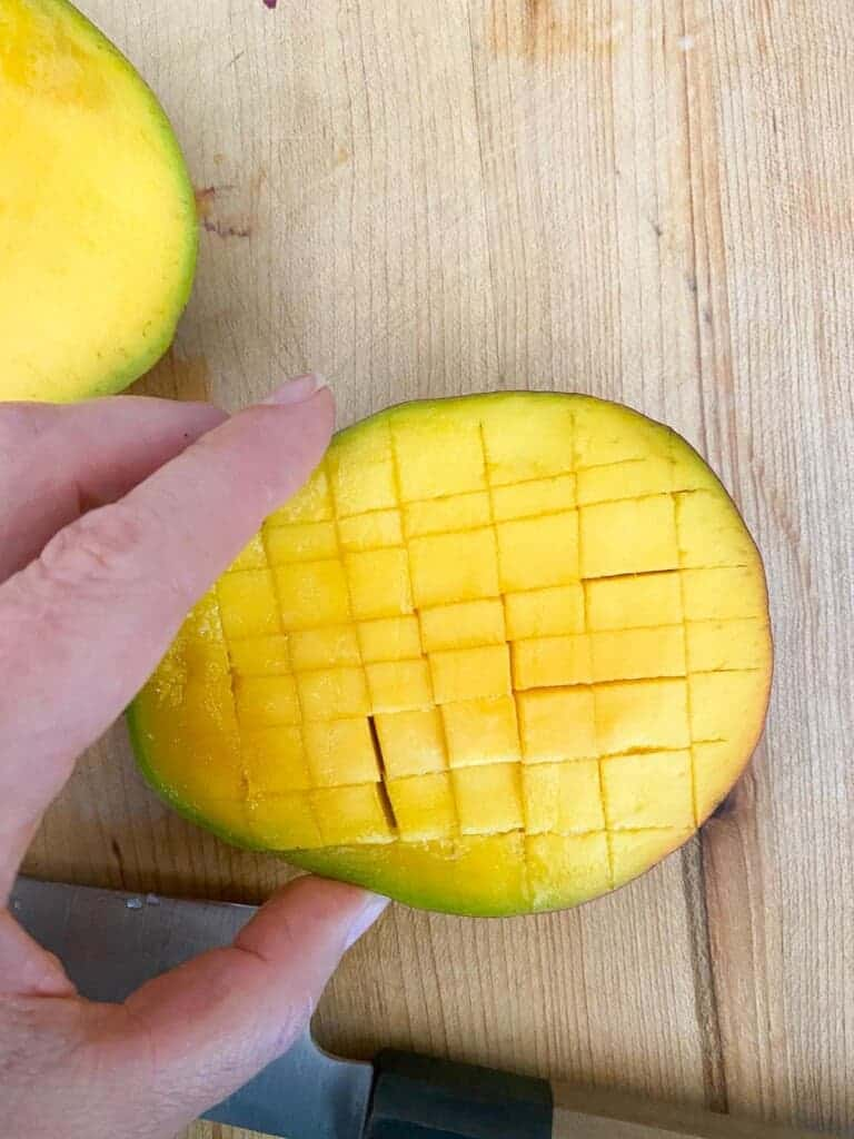 turn the mango and cut strips in the opposite direction